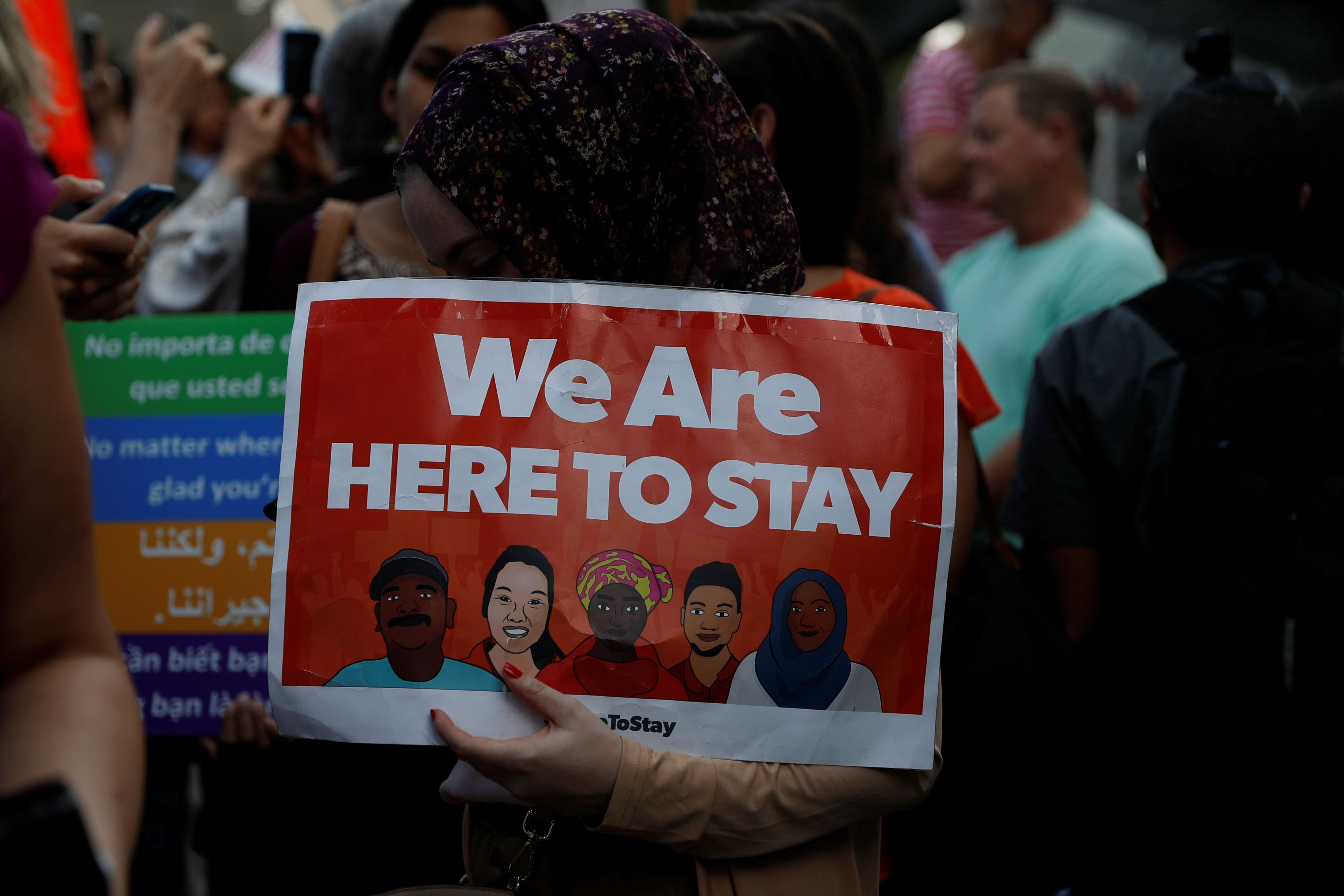 A demonstrator holds a sign during a rally against the rescindment of DACA (Deferred Action for Childhood Arrivals) program outside the San Francisco Federal Building in San Francisco, California, U.S., September 5, 2017. REUTERS/Stephen Lam