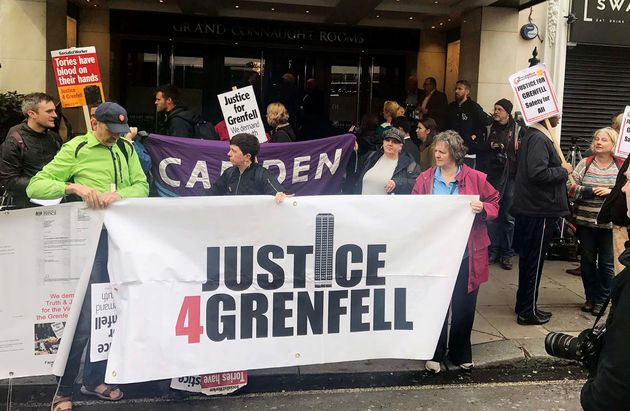 Protesters outside the Grenfell Tower public inquiry demonstrate before it