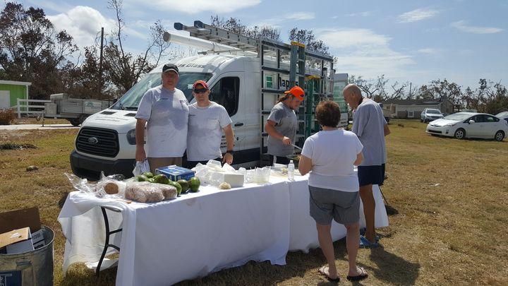Volunteers help serve food in Goodland, Florida.