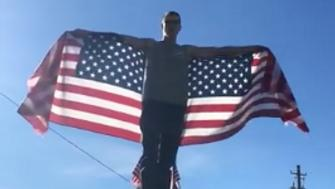 Billy Wilson on top of his truck after returning home from a Patriot Prayer rally