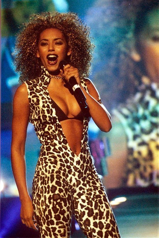 Grab anything leopard print, rock a bold lip, pick that hair, and you're basically the curly-haired pop icon of the 90s. Try