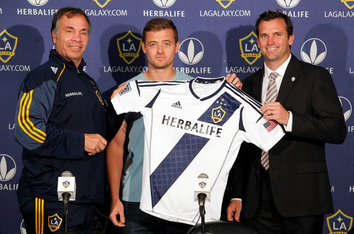 Los Angeles Galaxy head coach Bruce Arena (L) and team president Chris Klein (R) introduce the signing of midfielder Robbie Rogers at a news conference in Carson, California, on May 25, 2013.