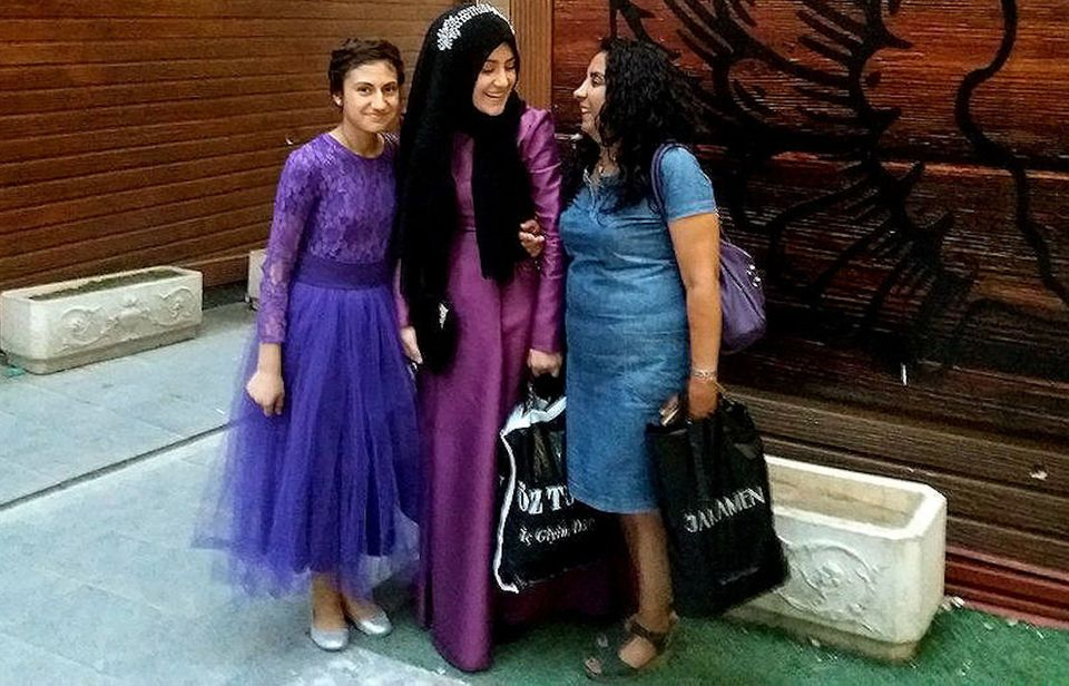 Gülmay Gümüşhan with two young girls on their way to a relative's wedding. Van,