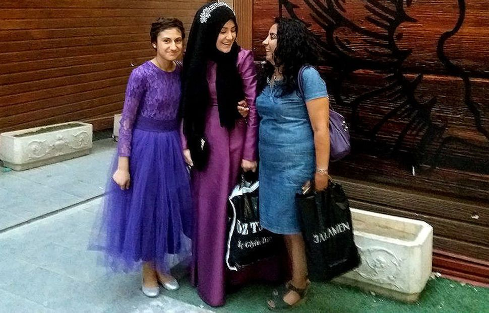Gülmay Gümüşhan with two young girls on their way to a relative's wedding. Van, Turkey.