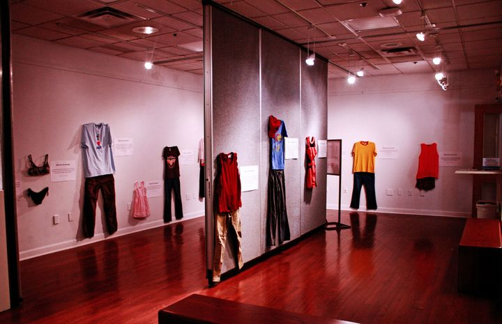 """A photo of the art exhibit """"What Were You Wearing?"""" at the University of Kansas."""