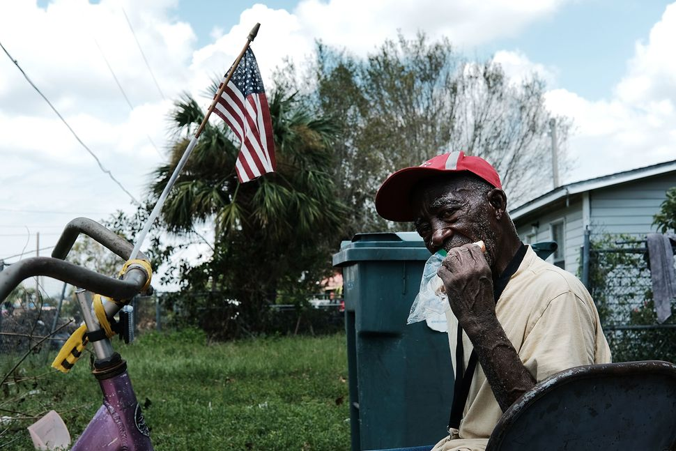 Lee Rigley in his yard in Immokalee, Florida, after Hurricane Irma.
