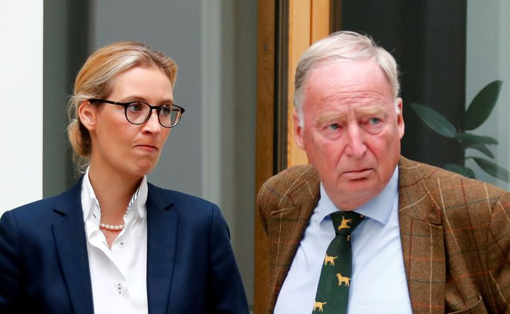 Alice Weidel (L) and Alexander Gauland of the anti-immigration party Alternative for Germany (AFD) react before they address