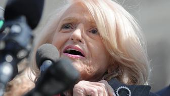 Plaintiff of the US v. Windsor case challenging the constitutionality of Section 3 of the Defense of Marriage Act (DOMA), 83-year-old lesbian widow Edie Windsor shows a diamond pin which her partner gave as engagement gift as she makes a statement to the media in front the Supreme Court on March 27, 2013 in Washington, DC. The US Supreme Court tackled same-sex unions for a second day Wednesday, hearing arguments for and against the 1996 US law defining marriage as between one man and one woman. After the nine justices mulled arguments on a California law outlawing gay marriage on Tuesday, they took up a challenge to the constitutionality of the federal Defense of Marriage Act (DOMA). The 1996 law prevents couples who have tied the knot in nine states -- where same-sex marriage is legal -- from enjoying the same federal rights as heterosexual couples. AFP PHOTO/Jewel Samad        (Photo credit should read JEWEL SAMAD/AFP/Getty Images)