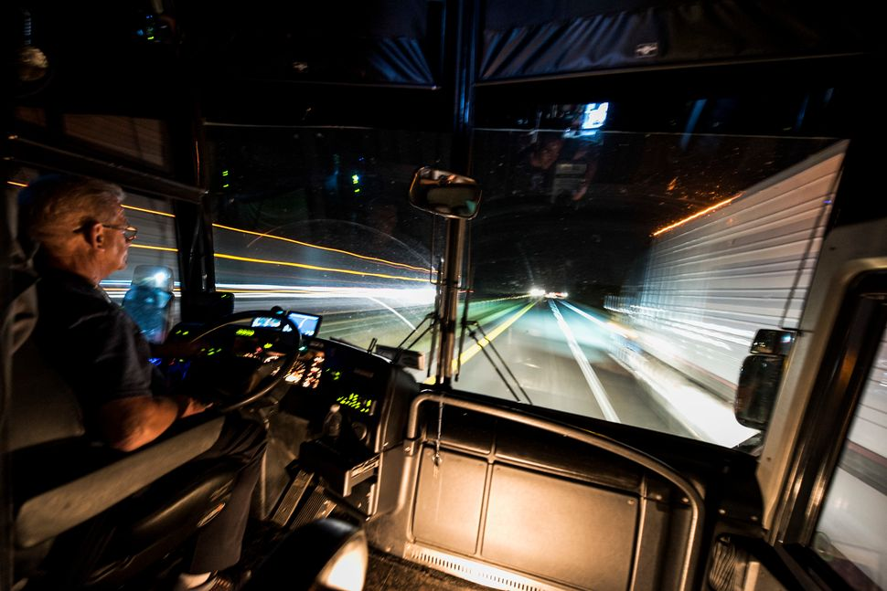 Bus driver Bobby Jensen does some late-night driving on the way to Oxford.