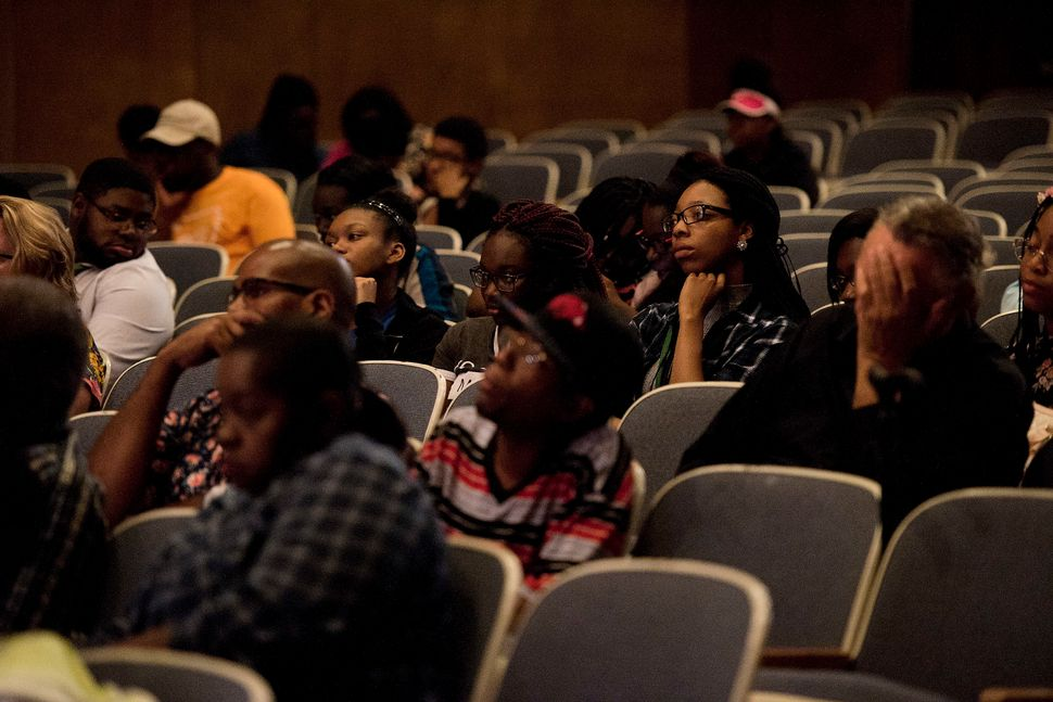 "The crowd listens to the speakers during the ""Victory Over Violence: Overcoming Gangs in Little Rock""€ event."