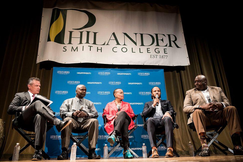 Moderator Kevin Kelly Listens to panelists Leifel Jackson, Joyce Elliott, Tristan Wilkerson and Police Chief Buckner talk abo