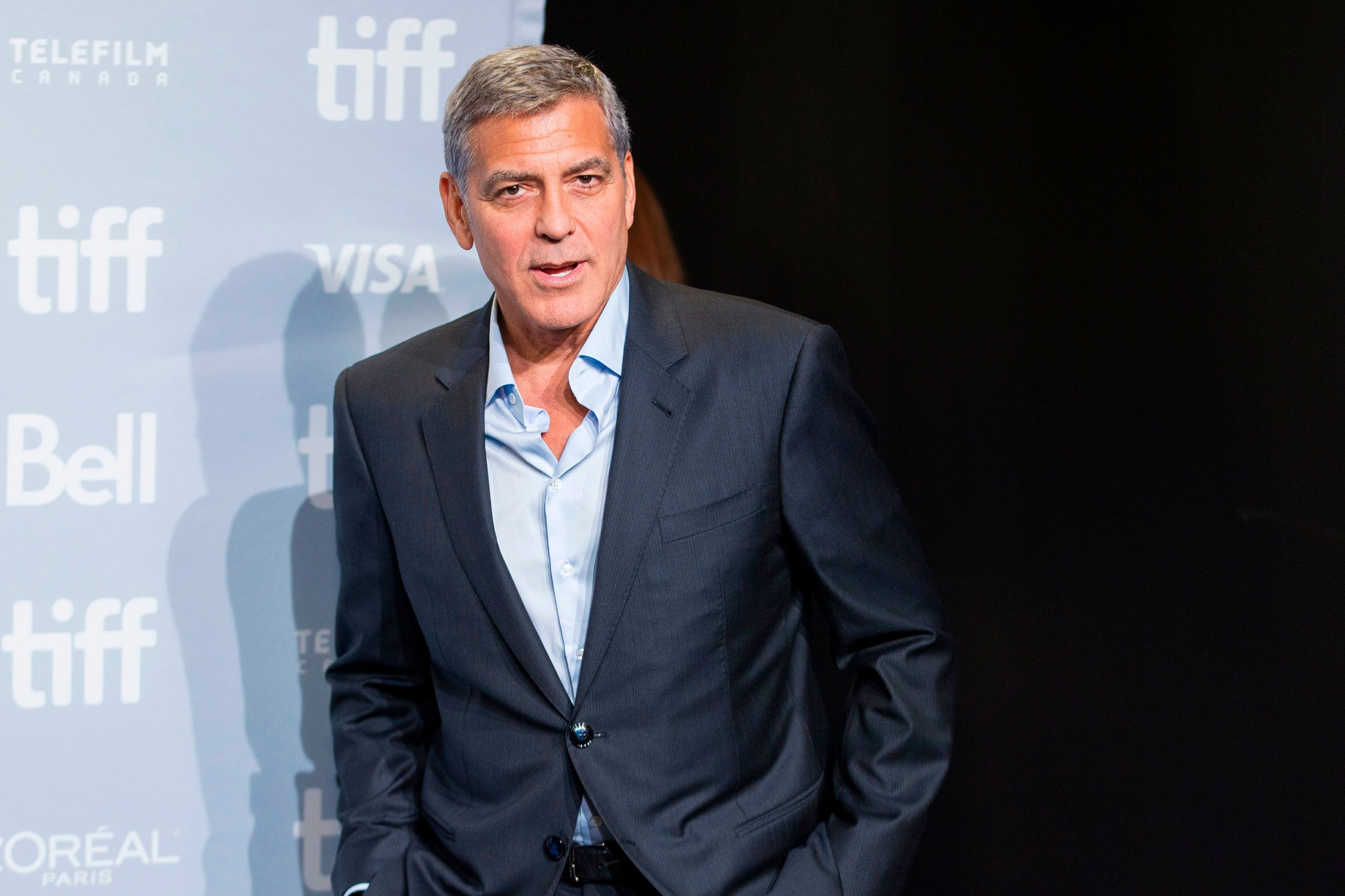 George Clooney: 'I cry four times a day because I'm so tired'