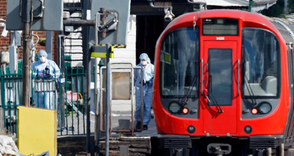 Police forensics officers work alongside a London Tube train at Parsons Green station in West London on Sept. 15, 2017, after