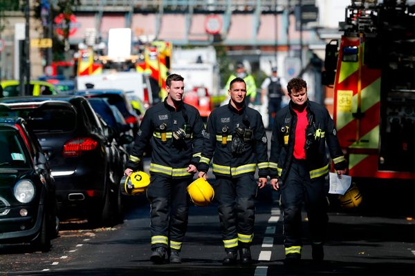 Members of the London Fire Brigade emergency service work near Parsons Green.