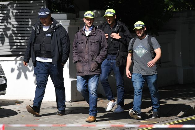 Plain-clothes police officers near Parsons Green