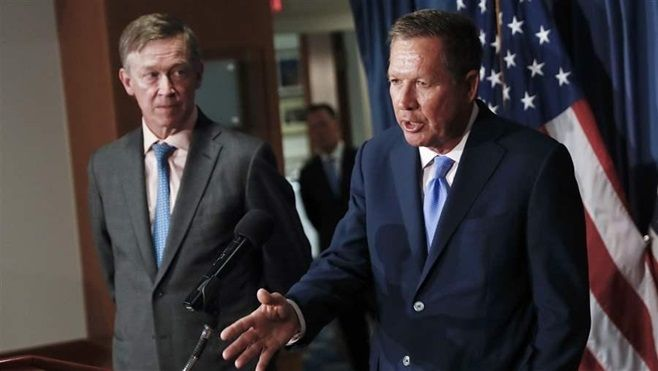 Govs. John Hickenlooper of Colorado (left) and John Kasich of Ohio discuss health care reforms in Washington in June. They ar