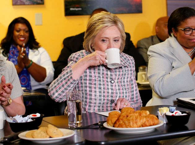 Clinton sips coffee during a campaign stop at a small restaurant in Vallejo, California on June...