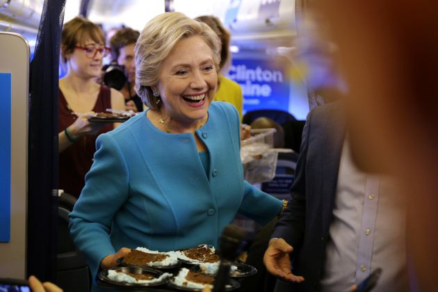 Clinton brings birthday cake to members of the media inside her campaign plane en route to New York on...