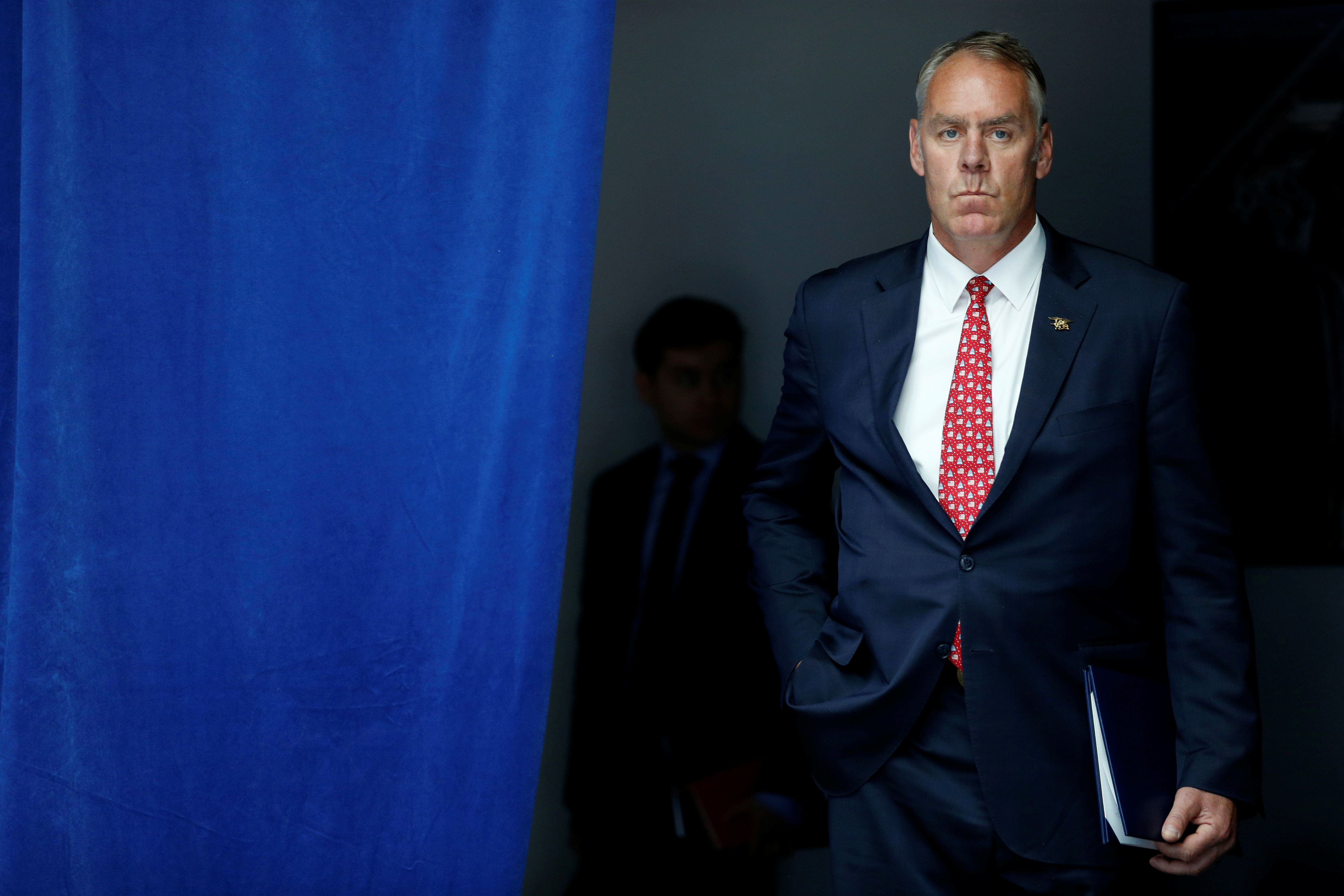 U.S. Interior Secretary Ryan Zinke waits to take the stage with President Trump for a speech on infrastructure in Washington,