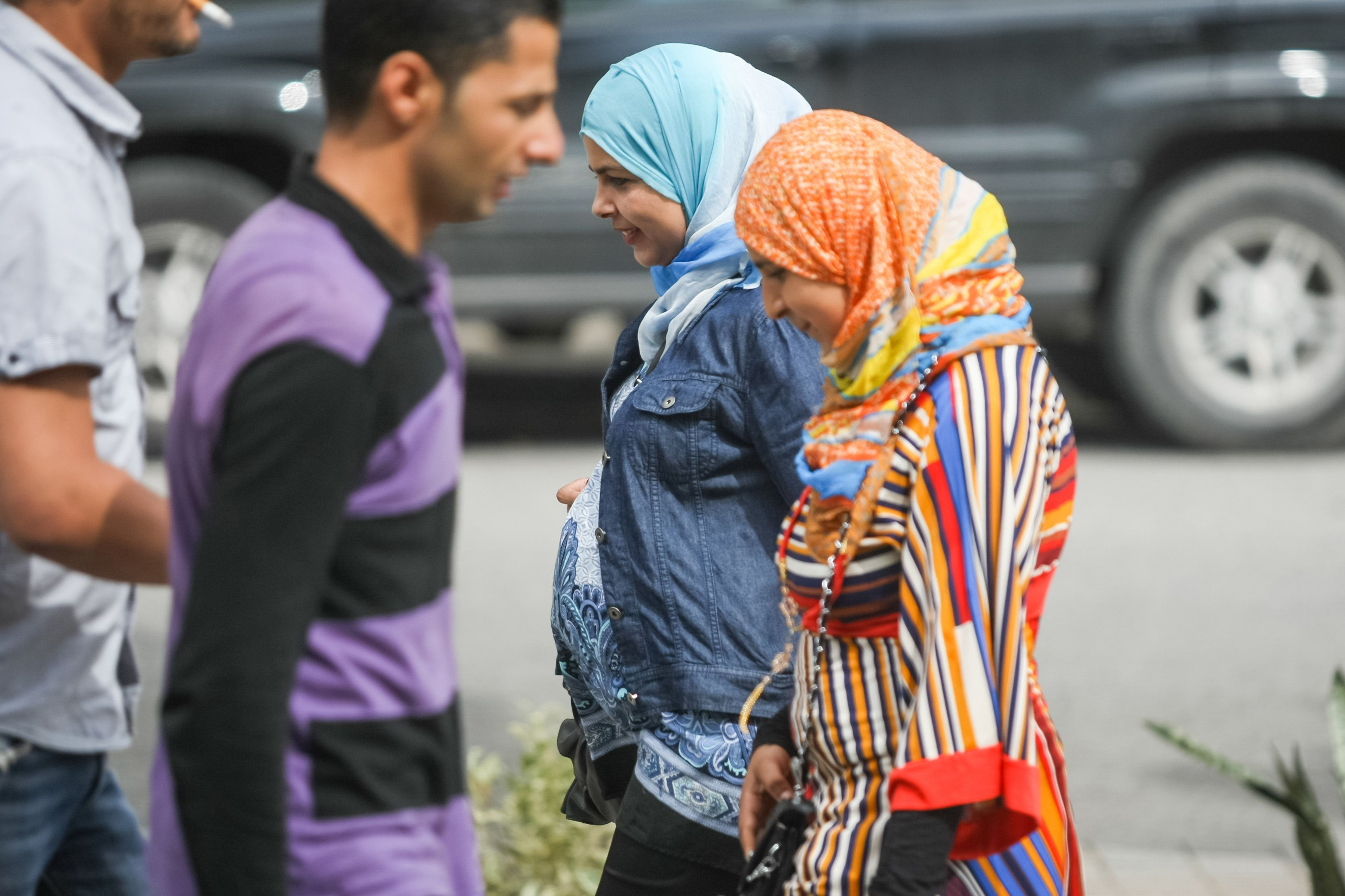 Tunis,Tunisia - September 14, 2012 : Close up of pregnant muslim woman walking in the city streets in Tunis,Tunisia.