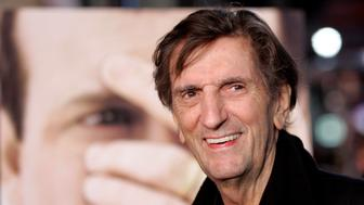 """Cast member Harry Dean Stanton smiles at the premiere of """"Big Love"""" at the Grauman's Chinese theatre in Hollywood February 23, 2006. The television series tells the story of polygamist Bill Henrickson played by Bill Paxton, who deals with three wives, all whom he is married to and his successful home improvement business. The series premieres on HBO on March 12. REUTERS/Mario Anzuoni"""