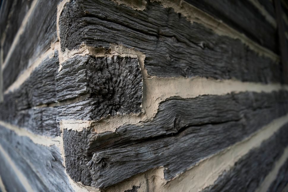 A detail of weathered wood on corner of a barn on The William Faulkner House property.