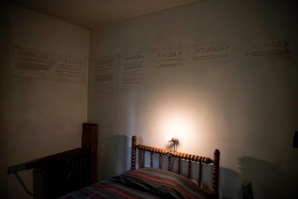 The outline of a book written on the walls in the William Faulkner House.