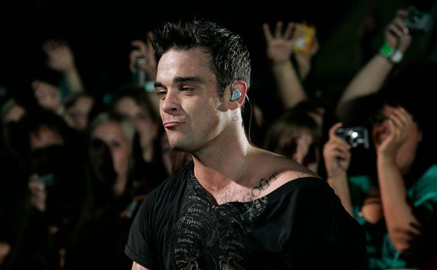 Robbie on stage during his 2006 tour Close
