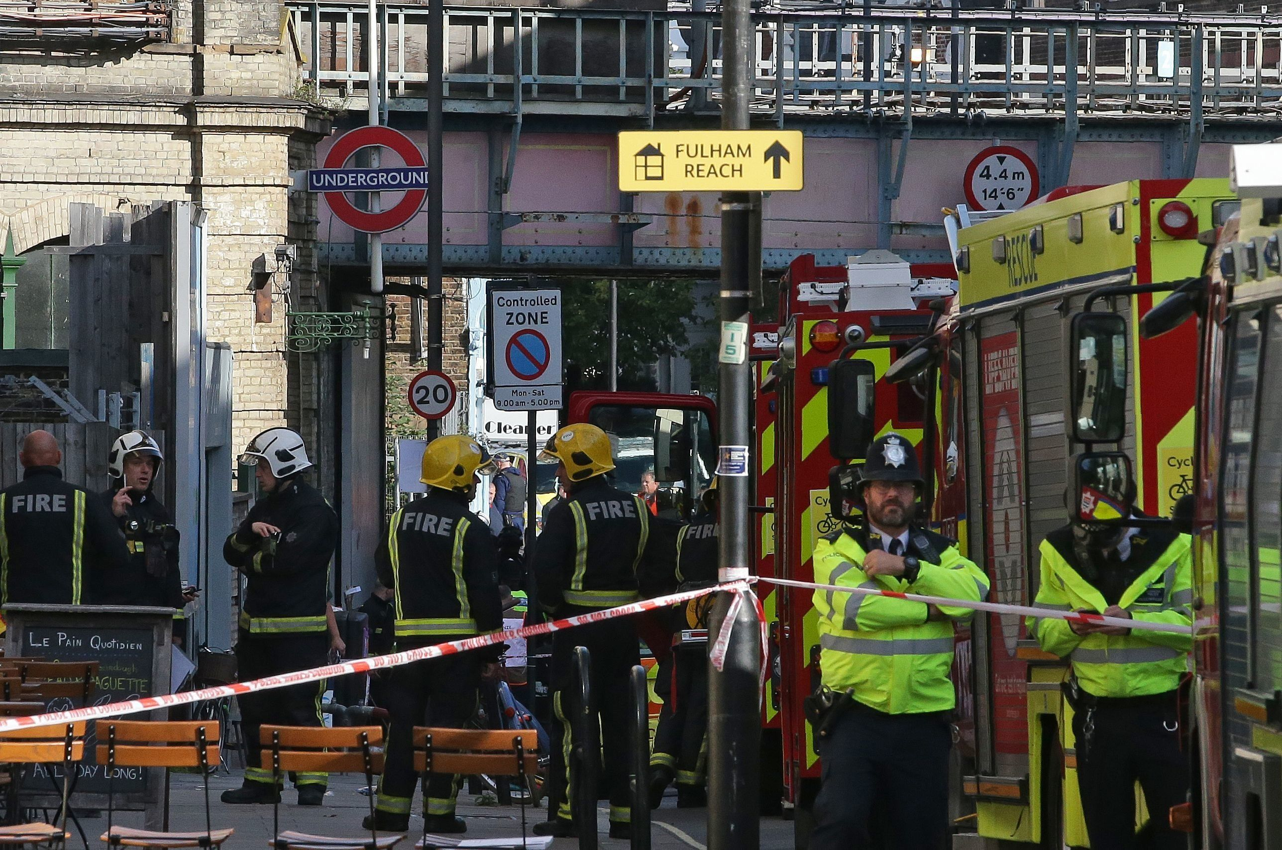 Members of the emergency services work outside Parsons Green tube following Friday's terror