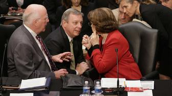 WASHINGTON, DC - MAY 20:  (L-R) Senate Judiciary Committee Chairman Patrick Leahy (D-VT), Sen. Richard Durbin (D-IL) and Sen. Dianne Feinstein (D-CA) discuss negotiations with Republicans during a markup session for the immigration reform legislation now before the committee in the Hart Senate Office Building on Capitol Hill May 20, 2013 in Washington, DC. The Judiciary Committee is hoping to wrap up work on the landmark immigration reform bill this week after wading through the 300 amendments that were filed to the bipartisan bill.  (Photo by Chip Somodevilla/Getty Images)