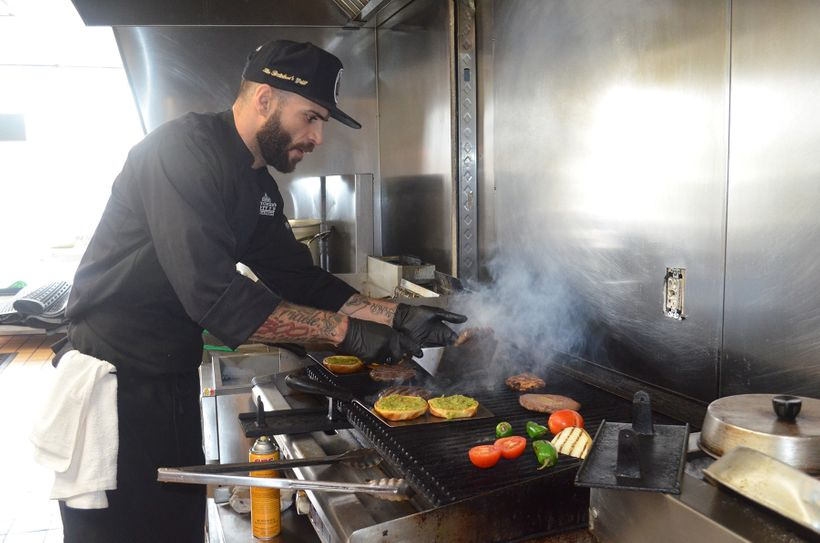 "Jawdat Hashem, the executive chef at ""The Butcher's Grille & Market"" in Dearborn, Mich., cooks up some burgers for the bu"