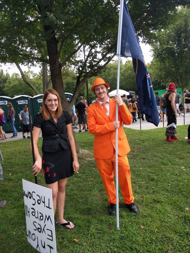 Zac, pictured in a bright orange suit and hat, came from Utah County, Utah. He said he has been harassed...