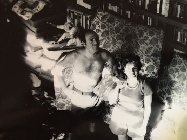 My parents in our flooded living room after Tropical Storm Doria. The water would rise to 6 feet.