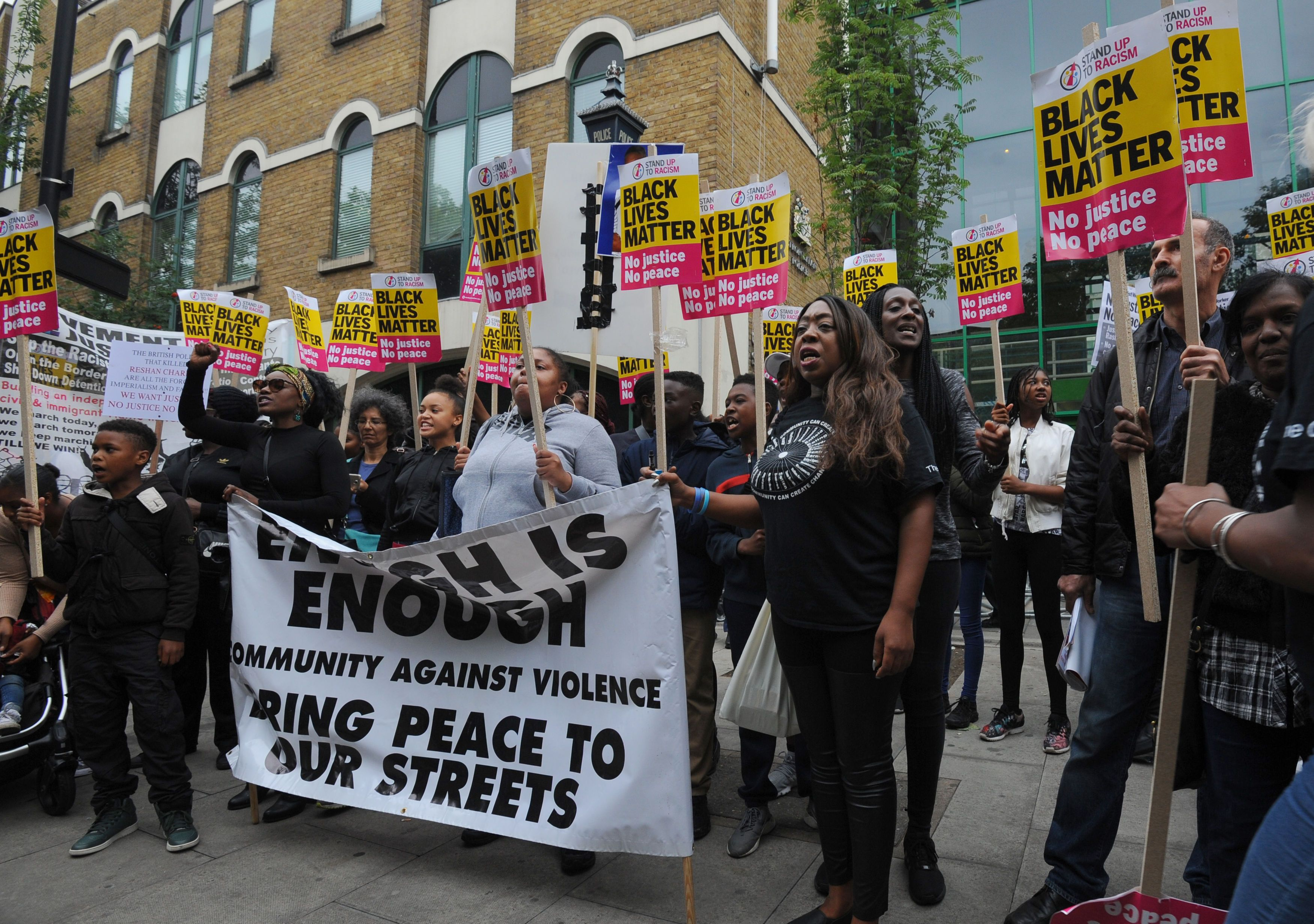 Members from Hackey Stand Up To Racism protest outside Stoke Newington Police