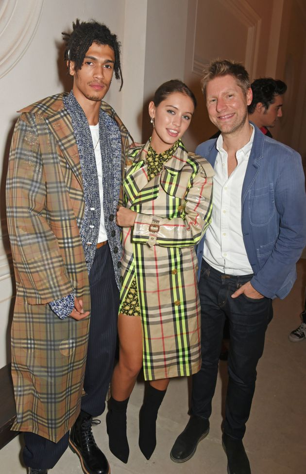 Kelvin Bueno and Iris Law with Burberry CEO Christopher
