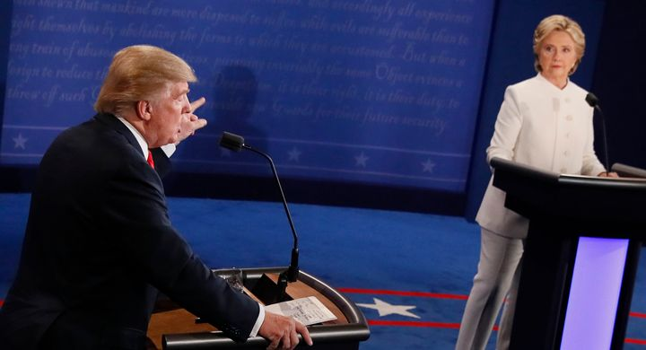 Then-Republican presidential nominee Donald Trump speaks as then-Democratic presidential nominee Hillary Clinton looks on during the final presidential debate on Oct. 19, 2016.