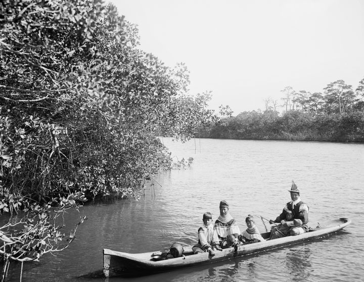 A photo taken in 1912 shows Seminole Indians in a dugout canoe on Florida's Miami River.