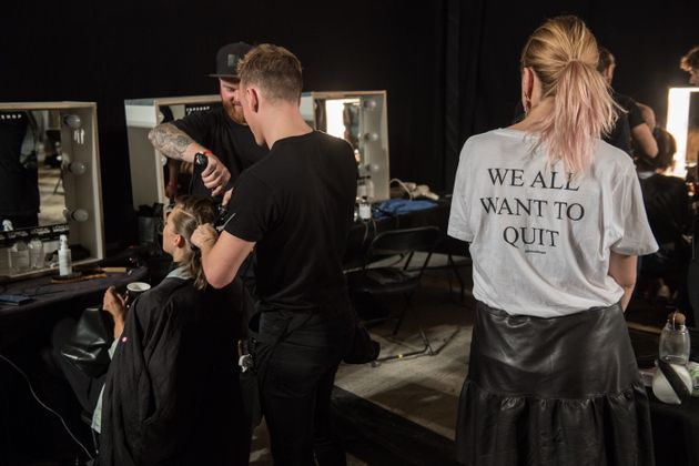Models have their hair styled backstage before the start of the Topshop catwalk show for the Spring/Summer...