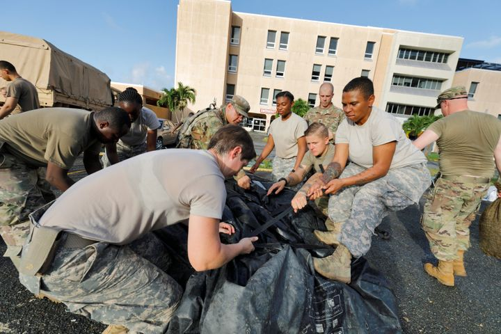 On the U.S. Virgin Islands on Sunday, soldiers from the 602nd Area Support Medical Company break down a field hospital outsid