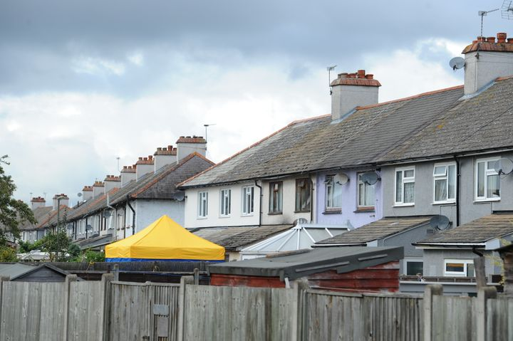 A police tent in the back garden of a house in Cavendish Road, Sunbury-on-Thames, Surrey, which is being searched by officers investigating the Parsons Green bombing.
