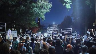ST LOUIS, MO - SEPTEMBER 16:  Demonstrators protesting the acquittal of former St. Louis police officer Jason Stockley march through University City on September 16, 2017 in St. Louis, Missouri. Dozens of business windows were smashed and at least two police cars were damaged during a second day of protests following the acquittal of Stockley, who had been charged with first-degree murder last year following the 2011 on-duty shooting of Anthony Lamar Smith.  (Photo by Scott Olson/Getty Images)