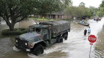 A military truck enters Lakeside Estate in Houston, Texas on August 30, 2017. Monster storm Harvey made landfall again Wednesday in Louisiana, evoking painful memories of Hurricane Katrina's deadly strike 12 years ago, as time was running out in Texas to find survivors in the raging floodwaters. / AFP PHOTO / Thomas B. Shea        (Photo credit should read THOMAS B. SHEA/AFP/Getty Images)
