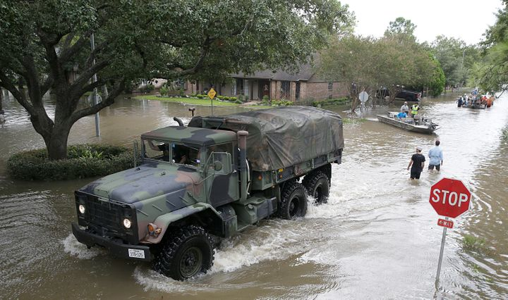 A military truck enters Lakeside Estate in Houston, Texas on August 30, 2017.