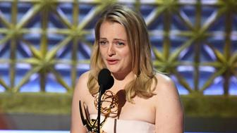 LOS ANGELES, CA - SEPTEMBER 17:  Actor Elisabeth Moss accepts Outstanding Lead Actress in a Drama Series for 'The Handmaid's Tale' onstage during the 69th Annual Primetime Emmy Awards at Microsoft Theater on September 17, 2017 in Los Angeles, California.  (Photo by Kevin Winter/Getty Images)