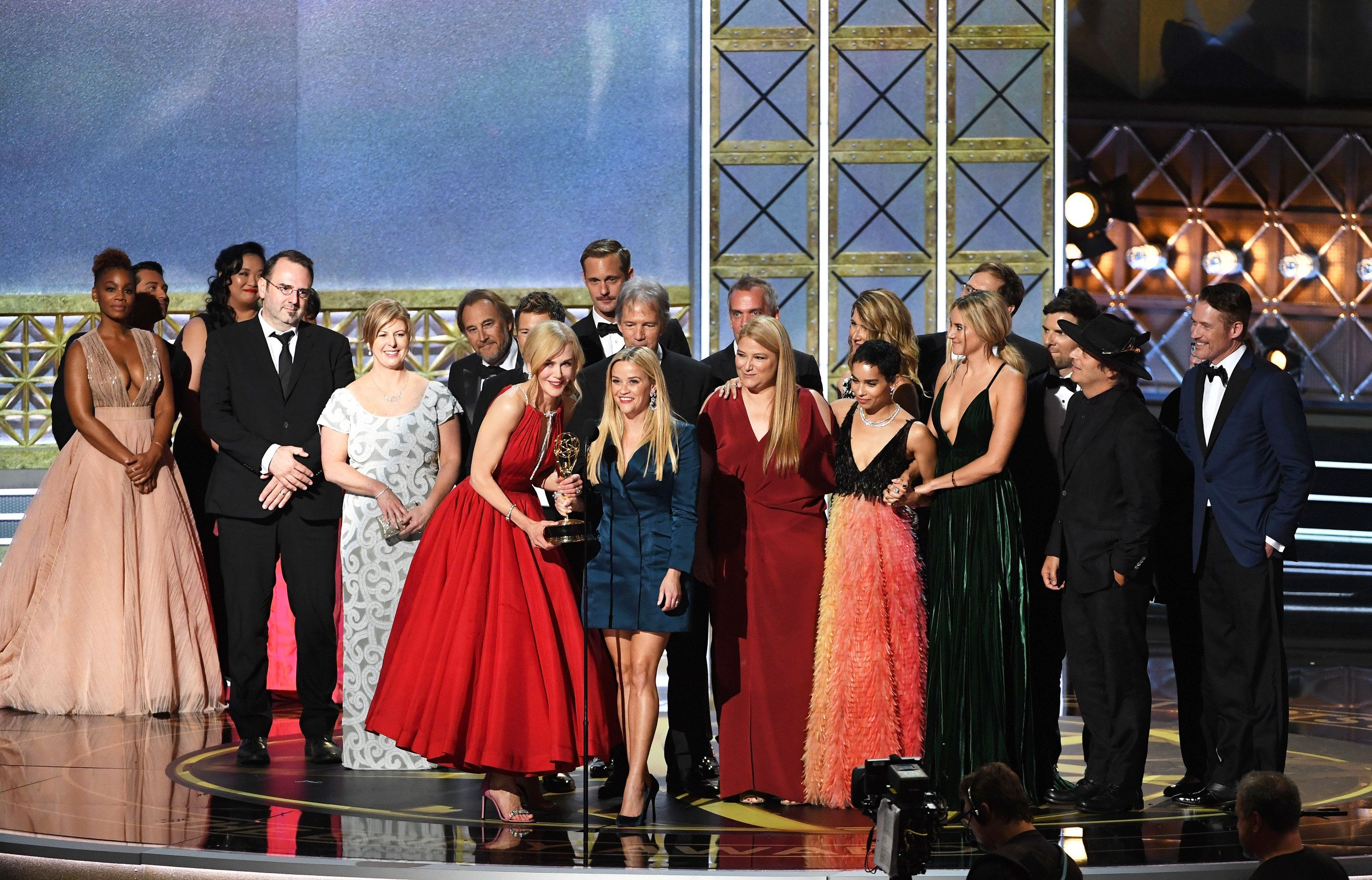 LOS ANGELES, CA - SEPTEMBER 17:  Actors Nicole Kidman and Reese Witherspoon (both at microphone) with cast and crew of 'Big Little Lies' accept the Outstanding Limited Series award onstage during the 69th Annual Primetime Emmy Awards at Microsoft Theater on September 17, 2017 in Los Angeles, California.  (Photo by Kevin Winter/Getty Images)