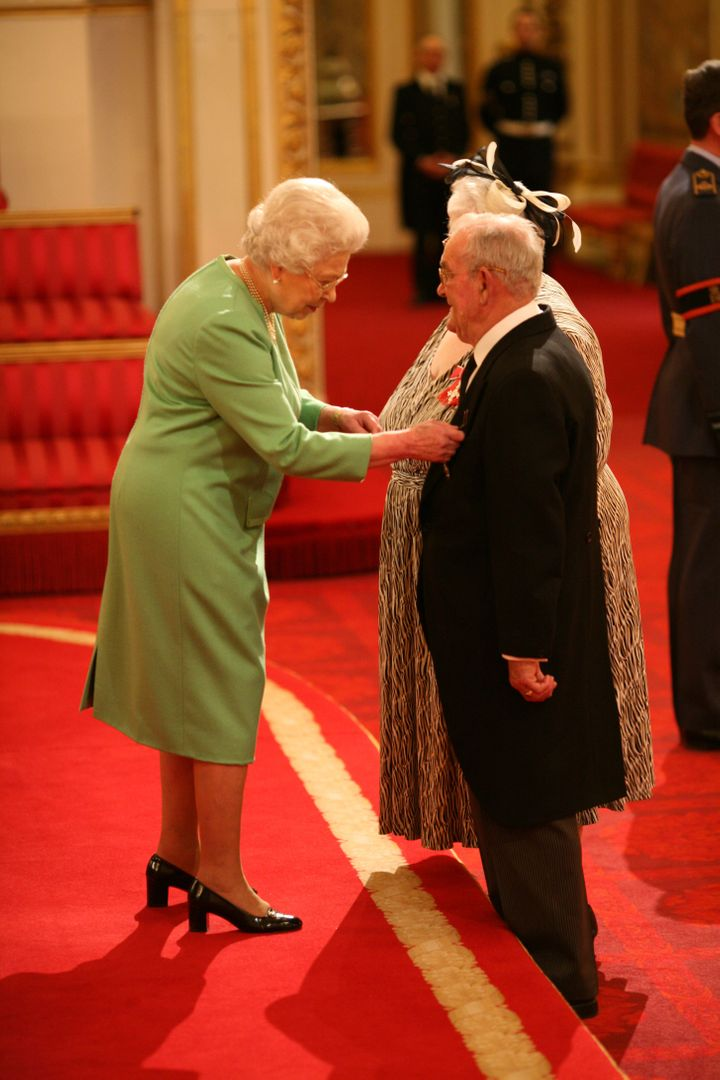 Penelope and Ronald Jones are made MBEs by Queen Elizabeth II at Buckingham Palace