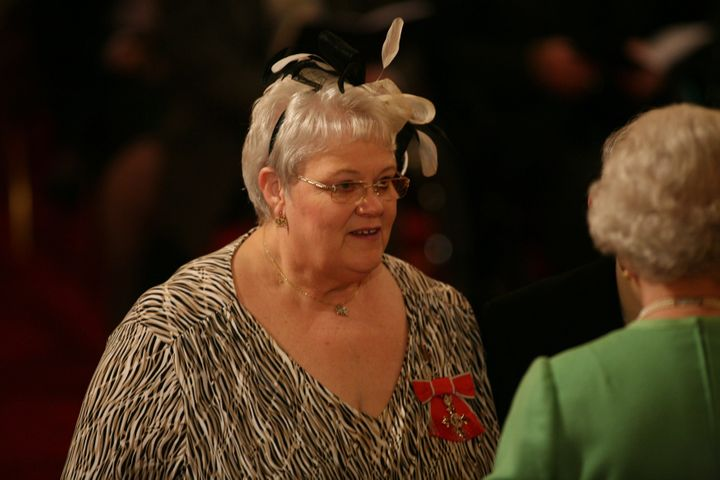 Penelope Jones as she receives her MBE