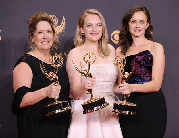 Actors Ann Dowd, Elisabeth Moss and Alexis Bledel pose with their acting Emmys for
