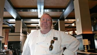"Celebrity chef Mario Batali poses in his latest restaurant, Del Posto, in New York April 11, 2006. Known to fans as ""Super Mario,"" his most recent venture, Del Posto, has attracted as much attention for the price of valet parking - $29, as for the quality of the food. Photo taken April 11, 2006.   To match feature Life-Food.   REUTERS/Brendan McDermid"
