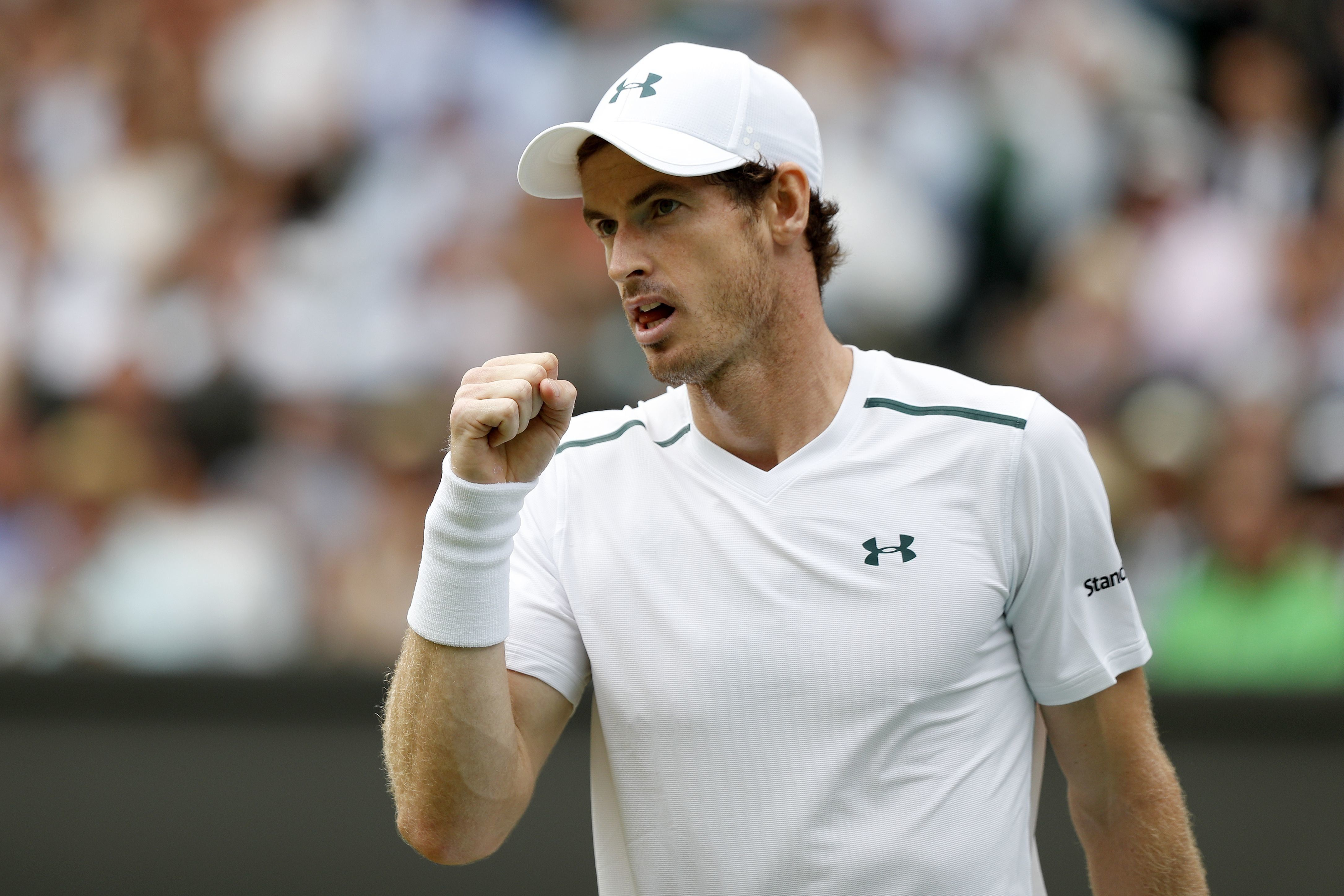 Britain's Andy Murray reacts after winning a point against France's Benoit Paire during their men's singles fourth round match on the seventh day of the 2017 Wimbledon Championships at The All England Lawn Tennis Club in Wimbledon, southwest London, on July 10, 2017. / AFP PHOTO / Adrian DENNIS / RESTRICTED TO EDITORIAL USE        (Photo credit should read ADRIAN DENNIS/AFP/Getty Images)